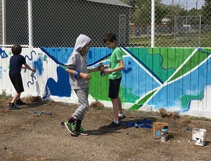 Kids with spray paint